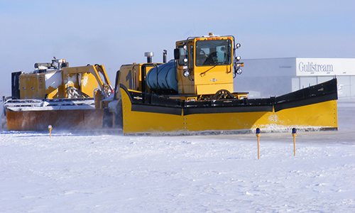 Snow plow clears roads at Outagamie County Regional Airport