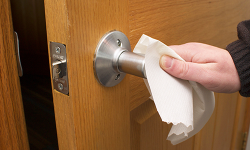 Opening a door with a disinfecting wipe